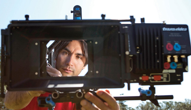 Filmmaker Sean White checking one of his custom 3D rigs. Photo by Arnold Lim, Vic News